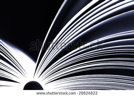 Opened book on dark background - ultramarine version - stock photo