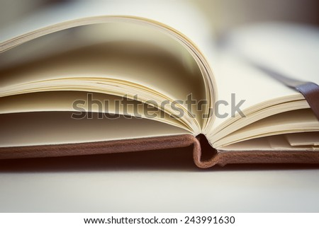 Opened book on the table. Close up. - stock photo