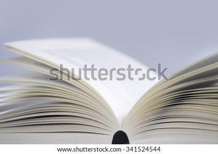 Opened book on the table with swallow depth of field - stock photo
