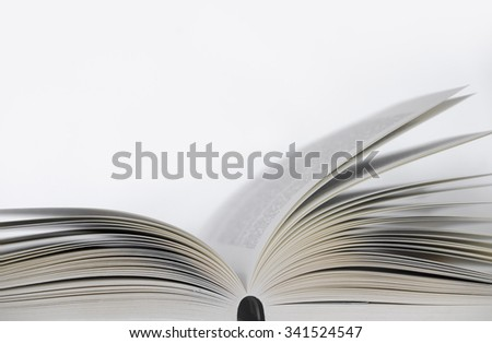 Opened book on the table with white background
