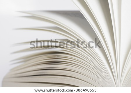 Opened book with shallow depth of field, white background