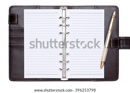 opened brown leather notebook and ballpoint pen isolated on white background