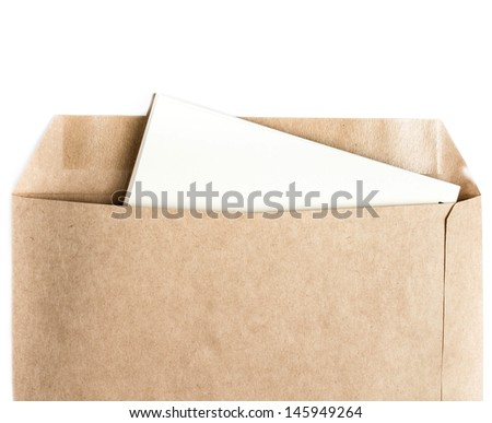 Opened brown Recycled craft  envelope with paper letter inside on white background, closeup - stock photo