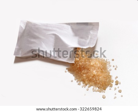 Opened brown sugar bag isolated on White background. - stock photo