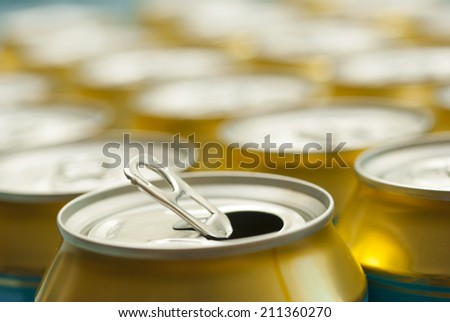 opened canned beer and many unopened