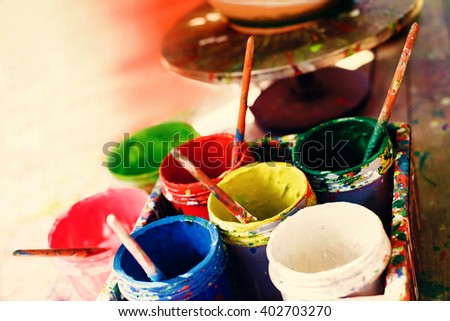 Opened cans with paint - stock photo
