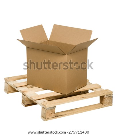 Opened cardboard box on palette - stock photo