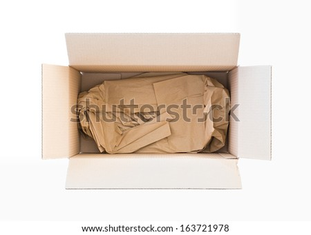 Opened carton box with paper inside isolated on white. Top view. - stock photo