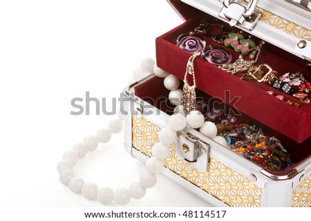 Opened casket filled with costume jewellery