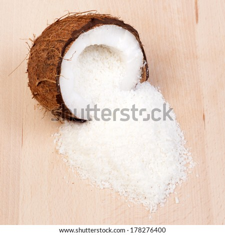 Opened coconut and flakes - stock photo
