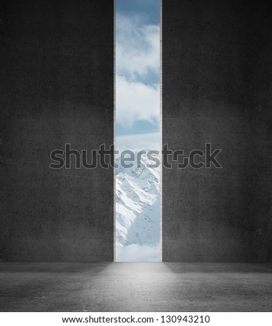 opened concrete wall with mountains - stock photo