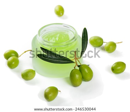 Opened container with cream and  green olives isolated on white - stock photo