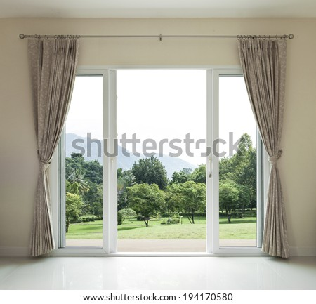 Opened door,  green garden view - stock photo