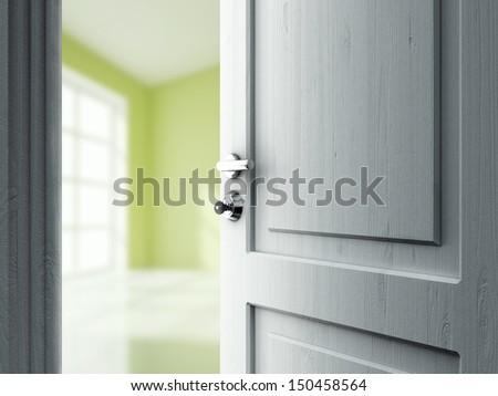 opened door in green room with window - stock photo