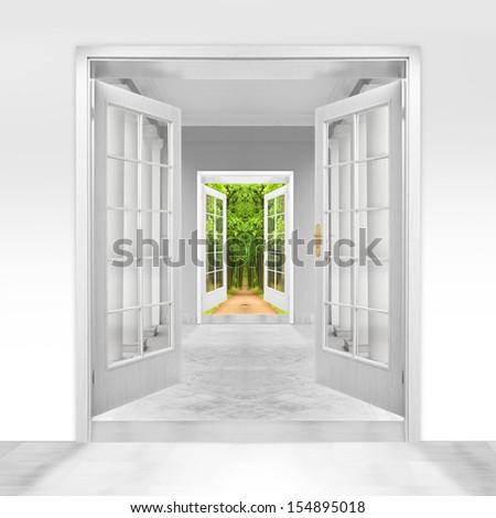Opened door to  green garden. Environmental business metaphor.  - stock photo