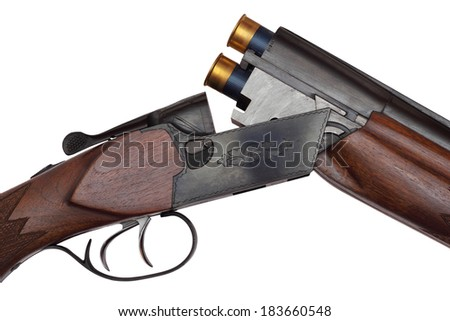 Opened double-barrelled hunting gun with two blue cartridges close-up photo isolated on white background - stock photo