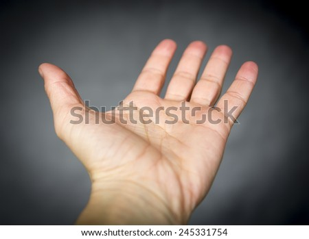 opened empty hand on gray background