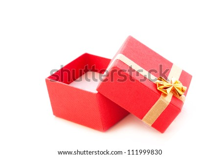 opened empty red jewelry box with gold ribbon on white background. - stock photo