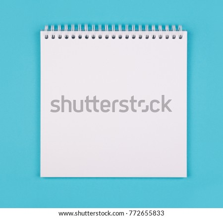 Opened empty white notepad on yellow background. Shot from top point of view with copy space