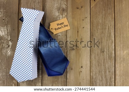 Opened Fathers Day handmade tie shaped gift box with tag on a rustic wood background - stock photo