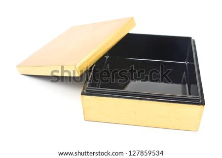 Opened golden gift box isolated on  white - stock photo
