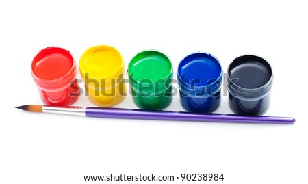 Opened gouache paint buckets with brush on the white background - stock photo