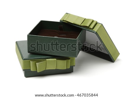 Opened green silk case box with a satin cloth inside isolated over white background, front view