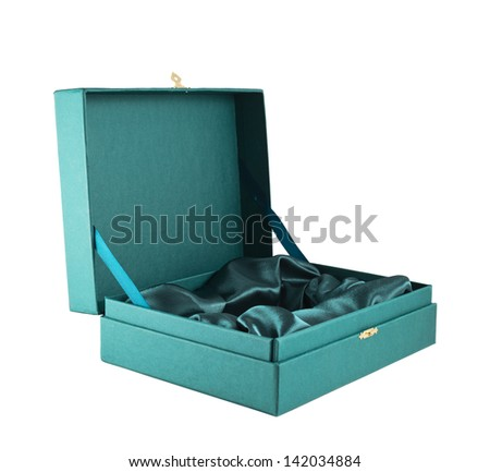 Opened green silk case box with a satin cloth inside isolated over white background, side view - stock photo