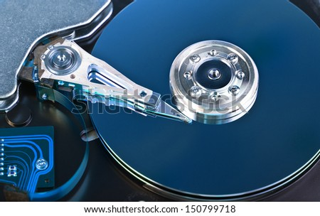 Opened Hard disk drive toned in blue - stock photo