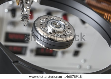 opened HDD disc drive and reflection of laboratory panel for testing PC components