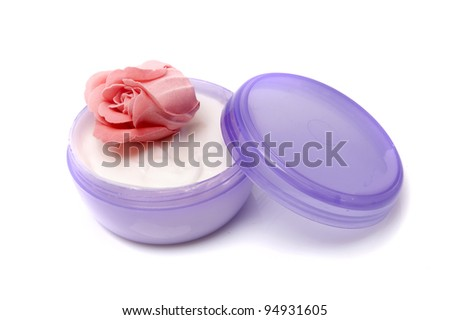 Opened jar of cosmetic cream isolated on white background