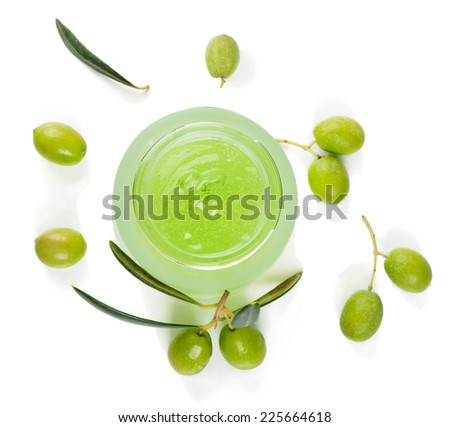 Opened jar of cosmetic green gel with air bubbles and fresh olives isolated on white, top view  - stock photo