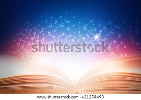 Opened magic book on abstract blue background