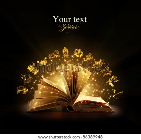 Opened magic book with magic zodiac symbols. Education. Zodiac - stock photo