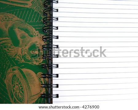 Opened notebook with beautiful green background - stock photo