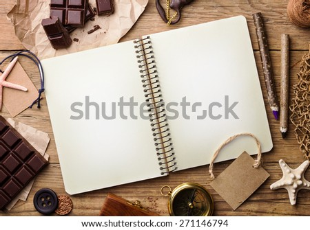 Opened notepad on old wooden table. Top view  - stock photo