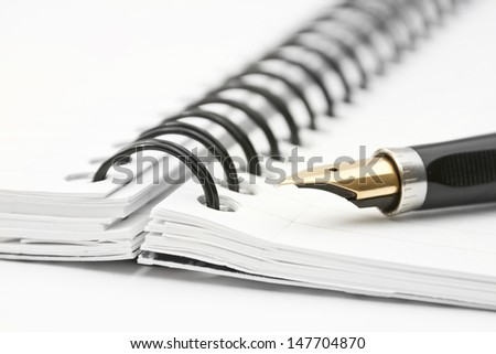 opened notepad with fountain pen  - stock photo