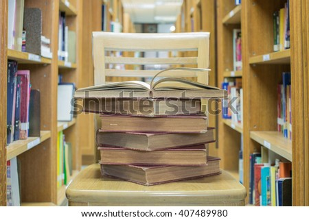 Opened old book in library room - stock photo