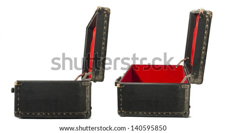 Opened old travel leather suitcase. Red color inside - stock photo