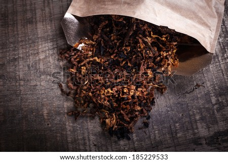 opened package of tobacco on a wooden surface
