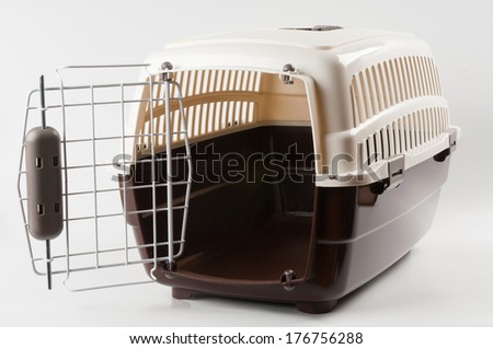 Opened pet travel plastic carrier on white - stock photo