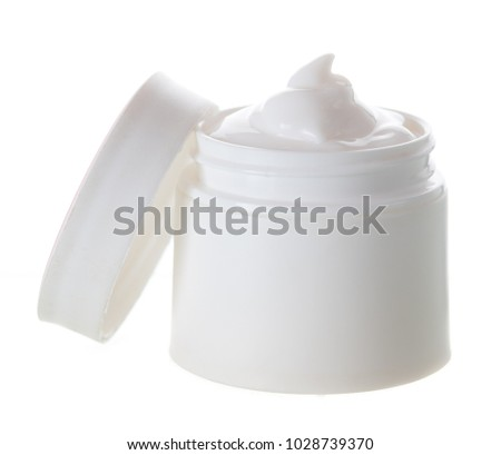 Opened plastic container with cream on a white background.