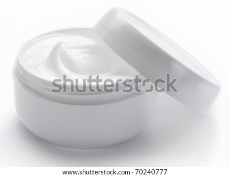 Opened plastic container with cream on a white background. - stock photo