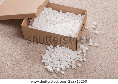 Opened post box with filler on carpet - stock photo