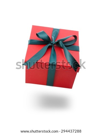 Opened red Christmas gift box with gold bow and ribbon   - stock photo
