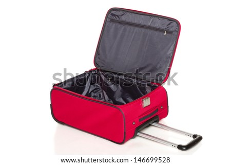 Opened red suitcase lying on the floor, isolated on white background