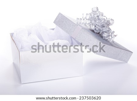 Opened silver gift box on a white background - stock photo
