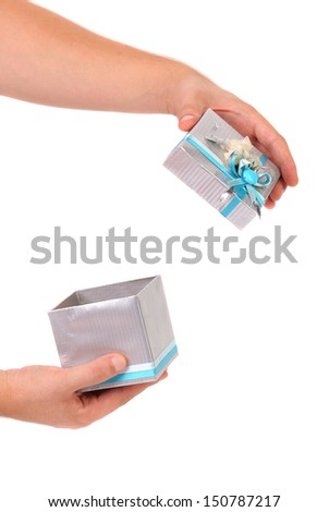 Opened silver gift box with blue ribbon. White background.