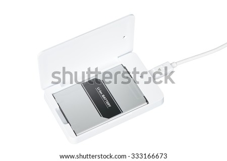opened white smartphone battery charger with usb cable