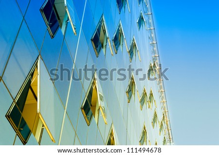Opened windows on the finance buildings - stock photo